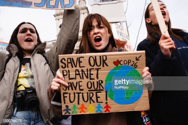 Young environmentalists take part in a 'climate strike' demonstration organised by the youth-led 'Fridays For Future' activist movement in Parliament...