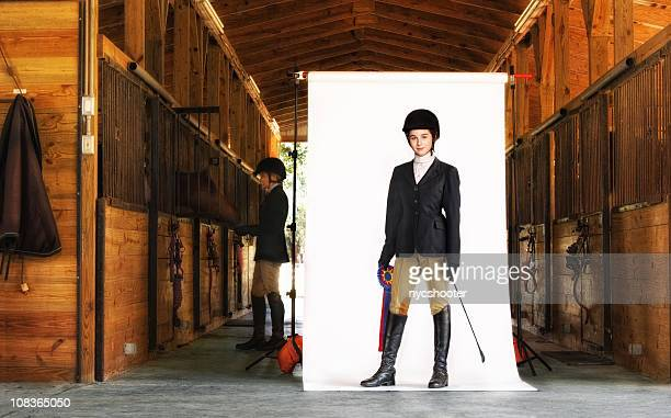 young equestrian isolated on white in barn - riding boot stock pictures, royalty-free photos & images