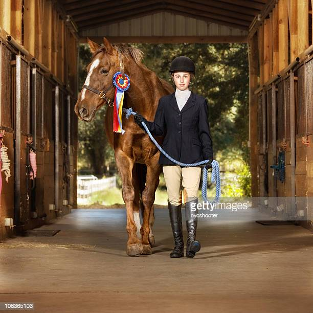 young equestrian with her horse - teen awards stock photos and pictures