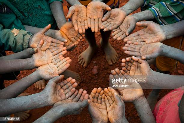 circle of open hands - vulnerability stock pictures, royalty-free photos & images