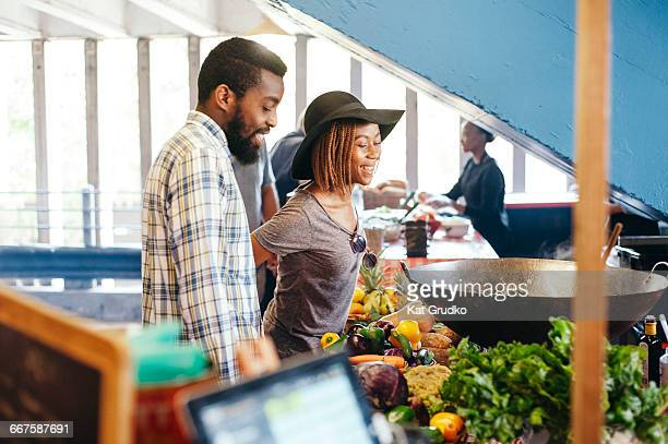 Young ethnic African couple browsing trendy market in Braamfontein Johannesburg South Africa
