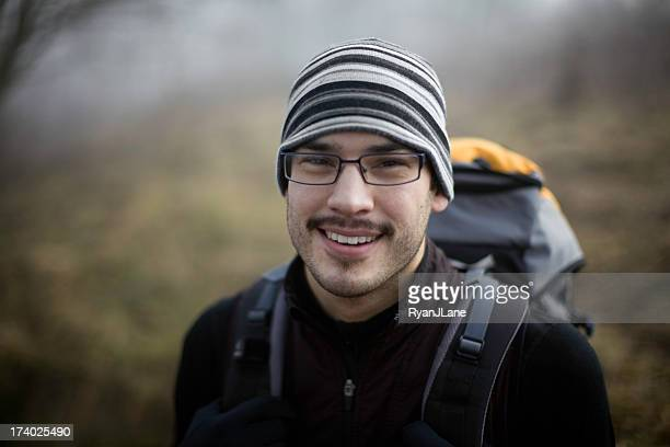 young ethnic backpacker in the woods - minority groups stock pictures, royalty-free photos & images