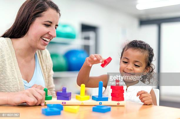 Young ethnic girl doing an exercise in a therapy session