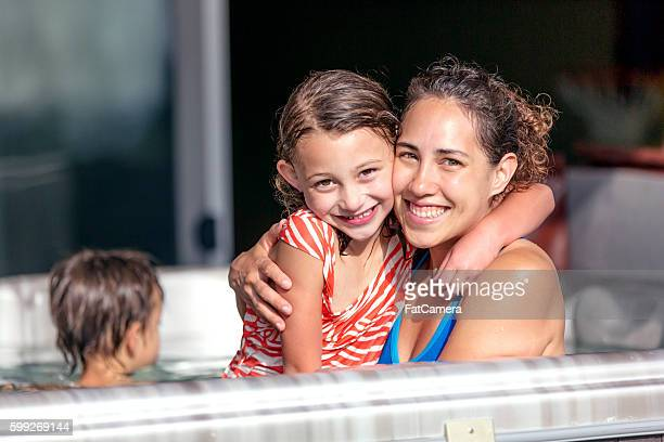 Young ethnic mother posing with her daughter in a