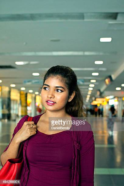 Young ethnic woman traveling alone