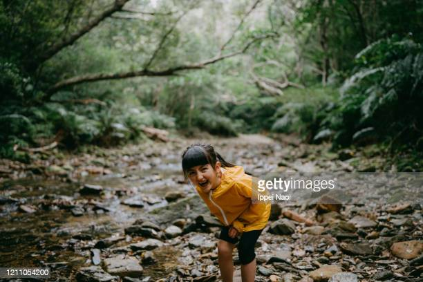 young eurasian girl laughing in forest, okinawa, japan - reality fernsehen stock pictures, royalty-free photos & images