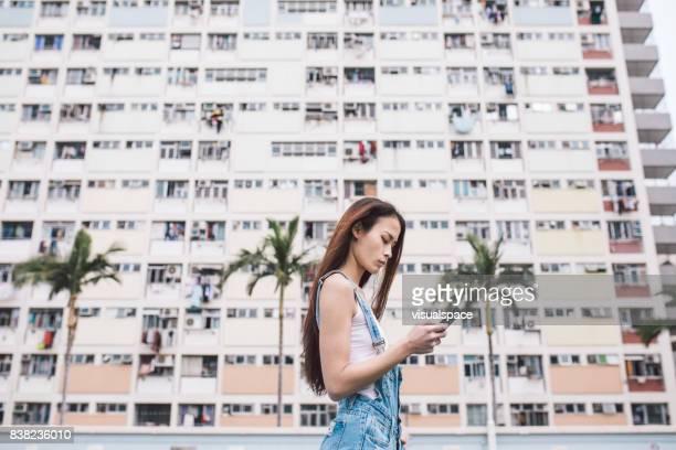Young Eurasian Woman Using Smart Phone