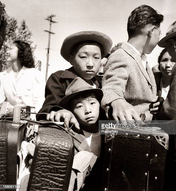 Young evacuees of Japanese ancestry await internment at Turlock California during World War Two on 2nd May 1942 This image is from the files of the...