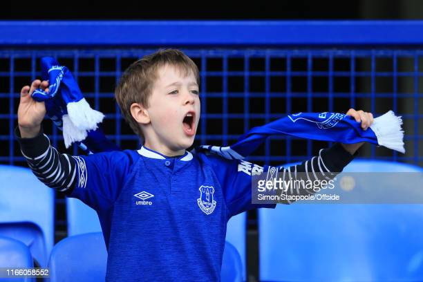 A young Everton fan cheers his side on during the Premier League match between Everton and Wolverhampton Wanderers at Goodison Park on September 1...