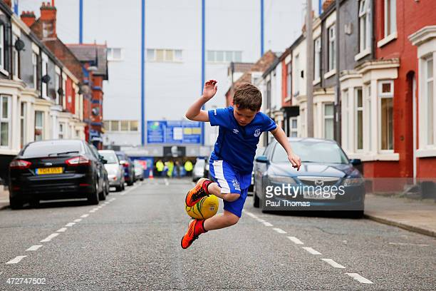 A young Everton fan juggles the ball prior to the Barclays Premier League match between Everton and Sunderland at Goodison Park on May 9 2015 in...
