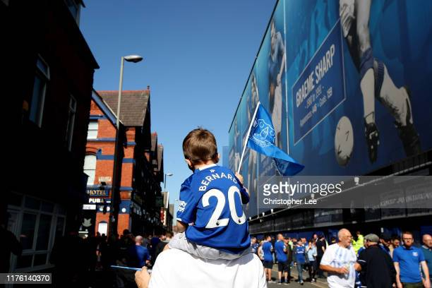 A young Everton fan waves a team flag prior to the Premier League match between Everton FC and Sheffield United at Goodison Park on September 21 2019...
