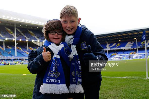 Young Everton fans pose for a photograph before the Barclays Premier League match between Everton and Swansea City at Goodison Park on March 22 2014...