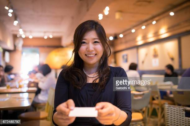 young executive director exchanging business card - one mid adult woman only stock pictures, royalty-free photos & images