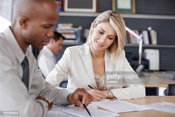 Young executives going through documents in business meeting
