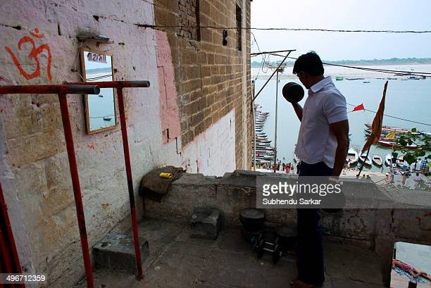 Young exercise in a traditional gymnasium on the ghats of the river Ganges in Varanasi, Uttar Pradesh, India.