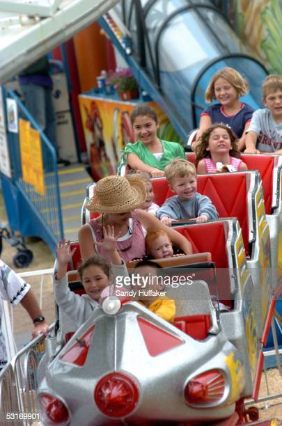 Young fairgoers enjoy a rollercoaster ride at the San Diego County Fair June 29 2005 in Del Mar California The fair features games rides live...