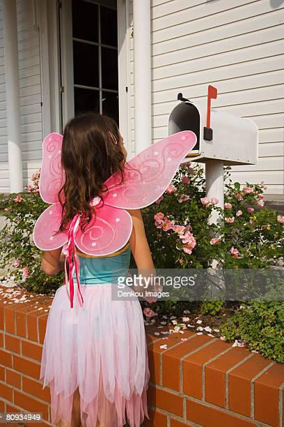 young fairy girl looking in mailbox - domestic mailbox stock pictures, royalty-free photos & images