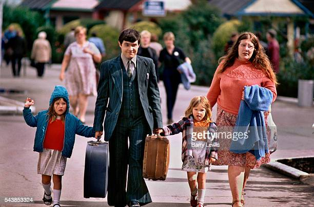A young family anongst the thousands of arrivals for the Saturday turnaround in Butlins holiday camp Skegness Butlins Skegness is a holiday camp...