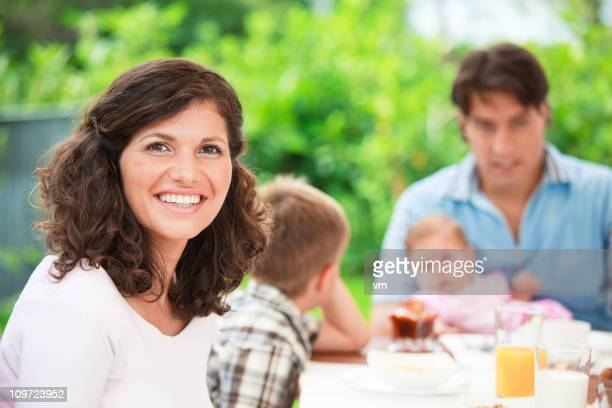 Young Family At Breakfast