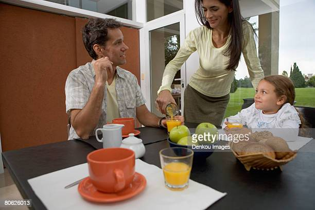 Young family at breakfast table