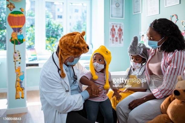 young family at the pediatrician - fancy dress costume stock pictures, royalty-free photos & images