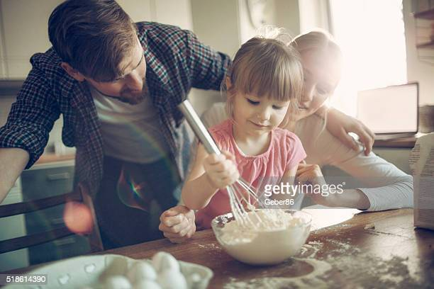 Young family baking together