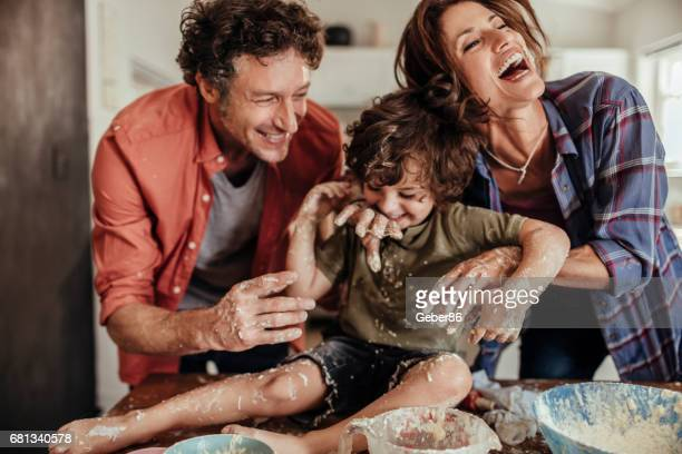 young family baking together - naughty wife stock photos and pictures