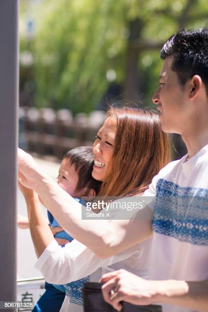 Young family buying a bottle of drink