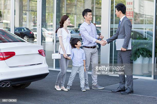 Young family buying car