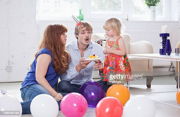 Young family celebrating a birthday