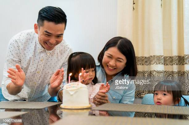 Young family celebrating birthday for daughter