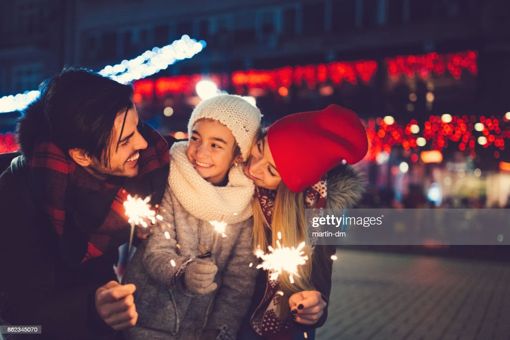 Young family celebrating Christmas : Stock Photo