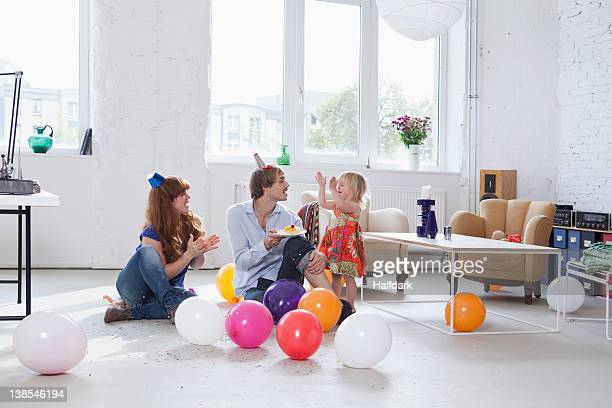 A young family celebrating their daughter's birthday