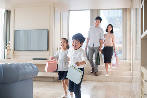 Young family coming back from shopping - gettyimageskorea