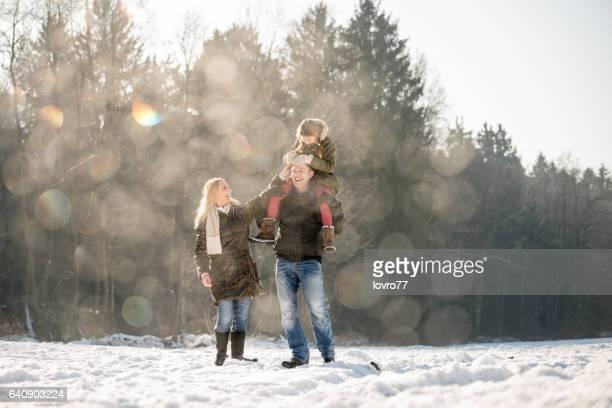 Young family enjoying a beautiful sunny winter day