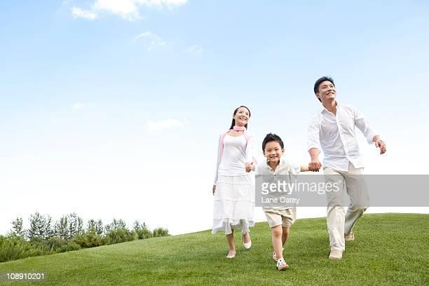 a young family enjoying the park - in the park day 3 imagens e fotografias de stock