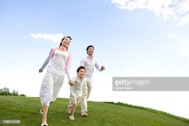 A young family enjoying the park