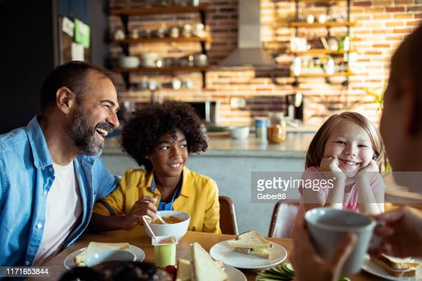 young family having breakfast - stepfamily stock photos and pictures