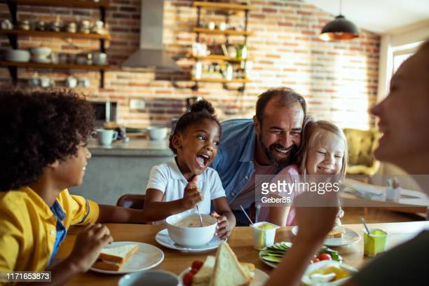 young family having breakfast - mixed race person stock pictures, royalty-free photos & images
