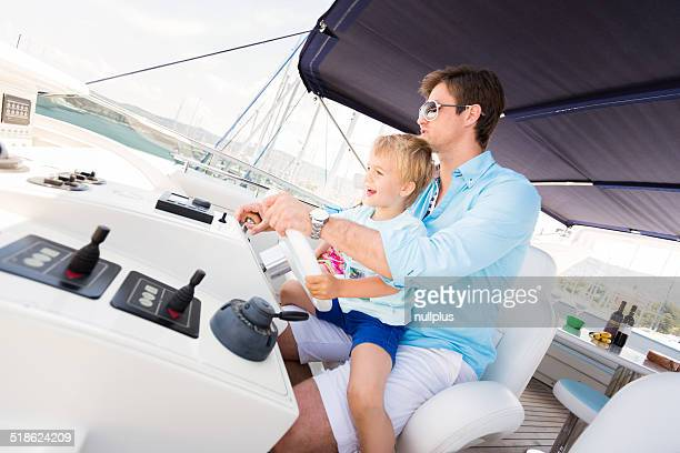 young family having fun on their yacht