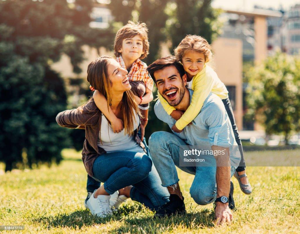 Young family having fun : Stock Photo