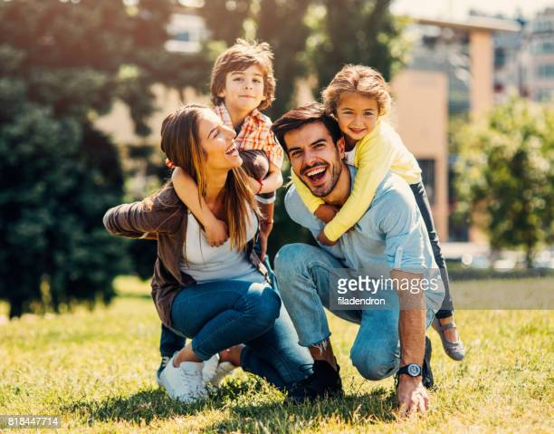 young family having fun - young family stock pictures, royalty-free photos & images