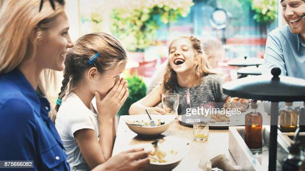 young family having lunch at a restaurant. - restaurant stock photos and pictures