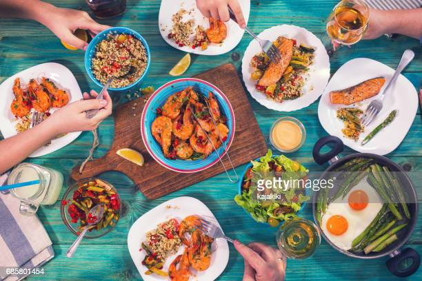 young family having lunch at home - seafood stock pictures, royalty-free photos & images