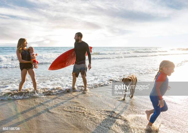 Young family having on the beach.