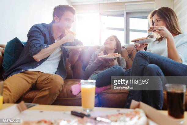 young family having pizza for lunch