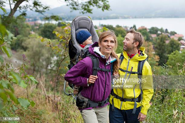 young family hiking together, girl in baby carrier