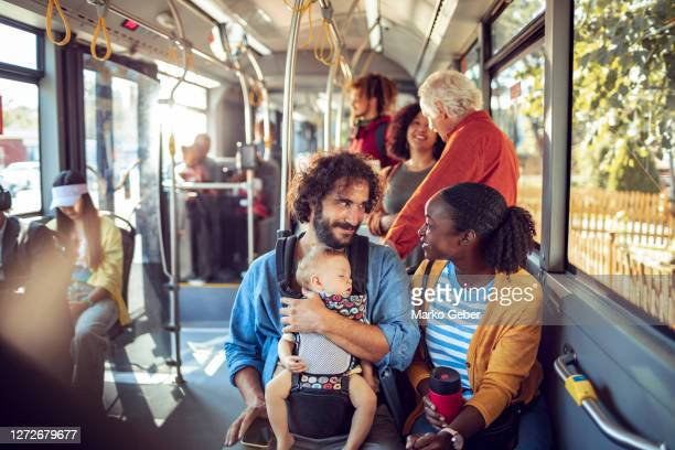 young family in a bus - public transportation stock pictures, royalty-free photos & images