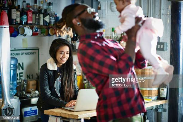 young family in motorcycle workshop. - alternative lifestyle stock pictures, royalty-free photos & images