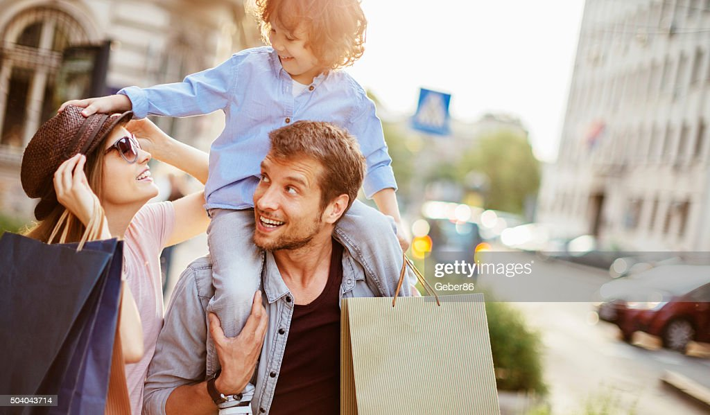Young family in shopping : Stock Photo